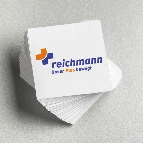 Kärtchen mit Reichmann Logo